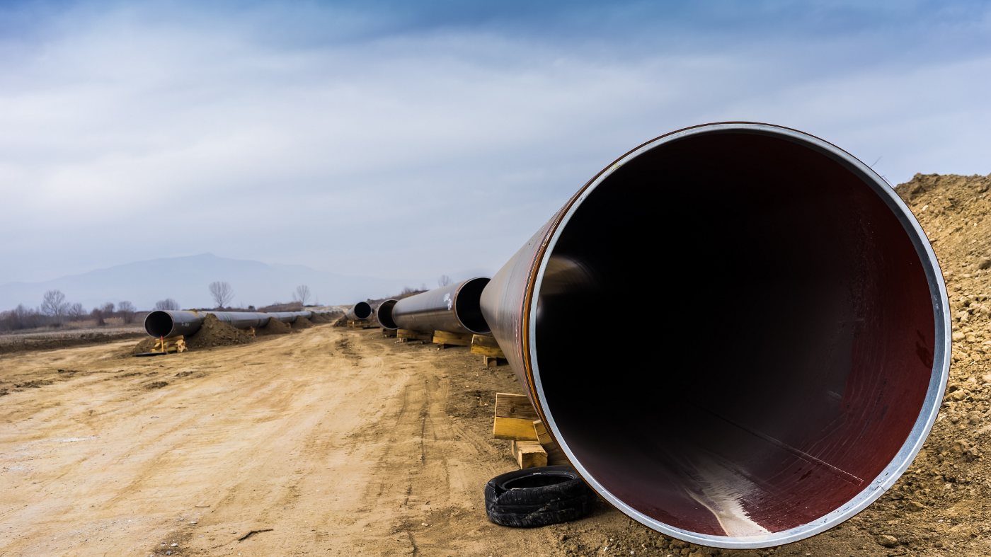 A close-up shot of the opening of a pipeline on dry and arid land