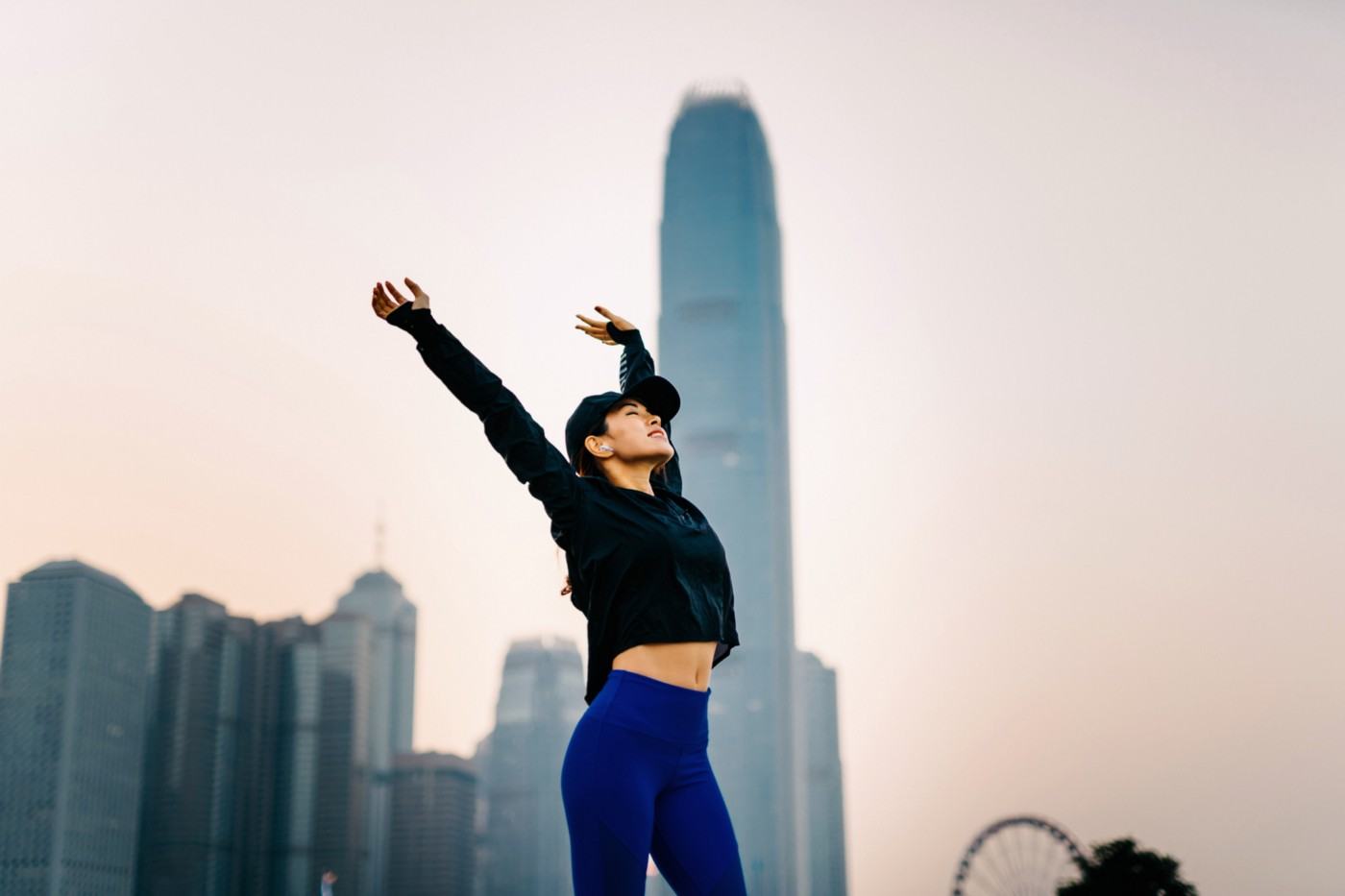 Woman stretching outside.