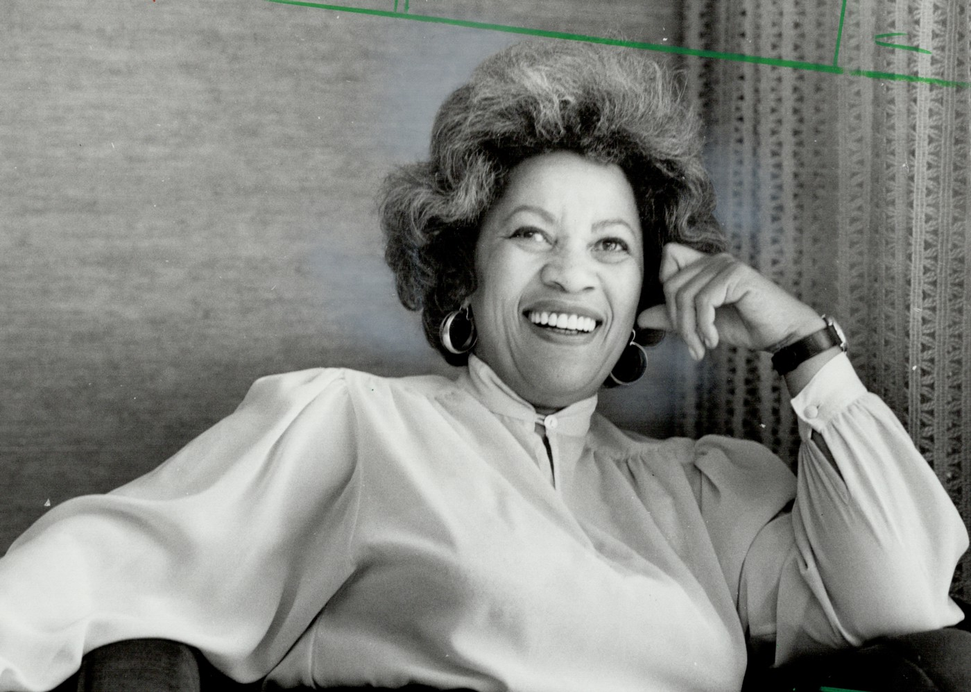 Black and white photo of Toni Morrison smiling.