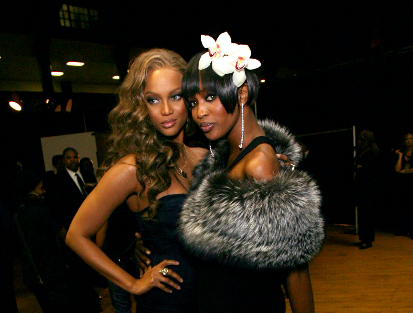 A photo of Tyra Banks and Naomi Campbell posing together for the camera.