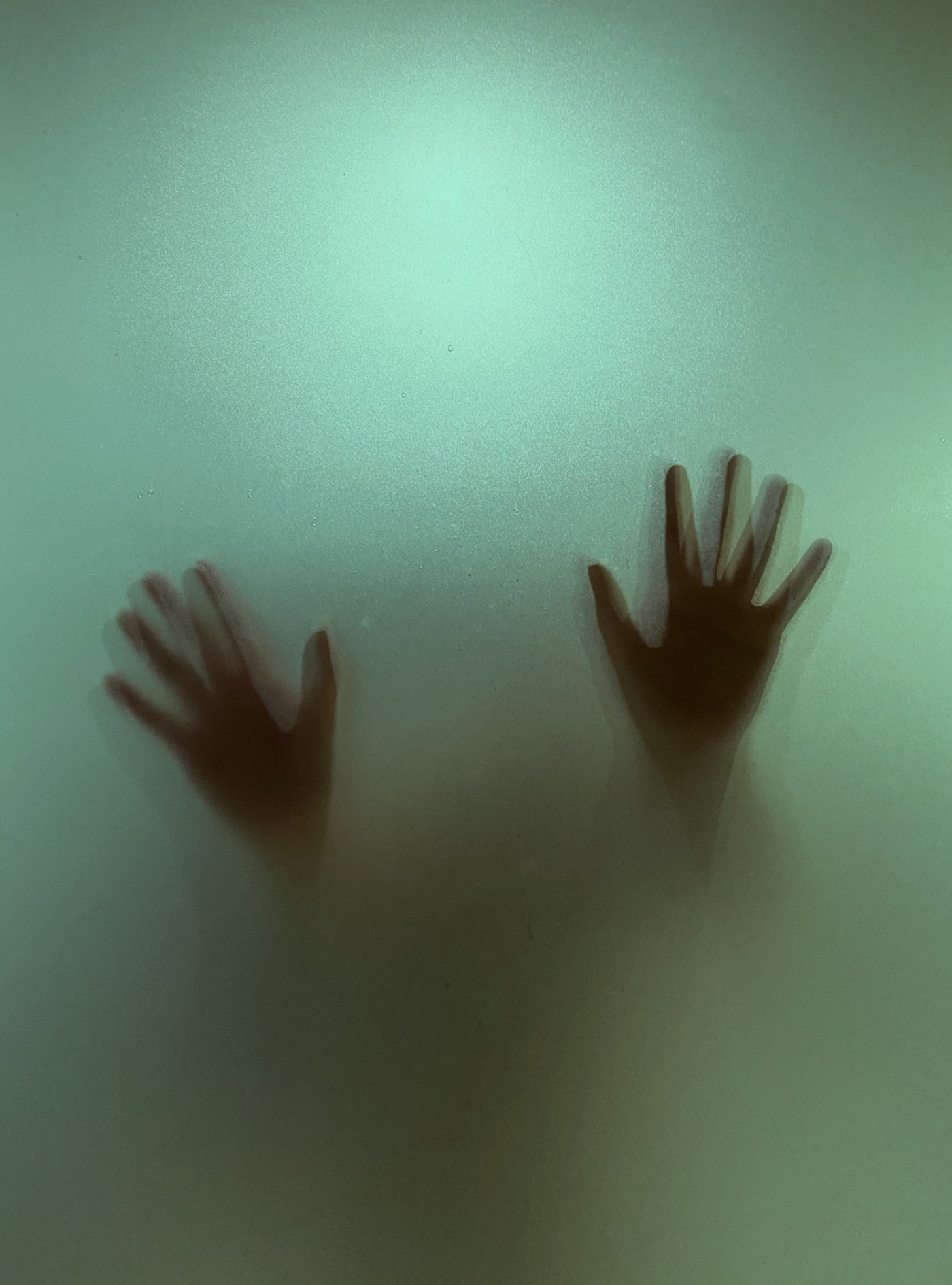 hand sitting on palm facing up on a foggy glass