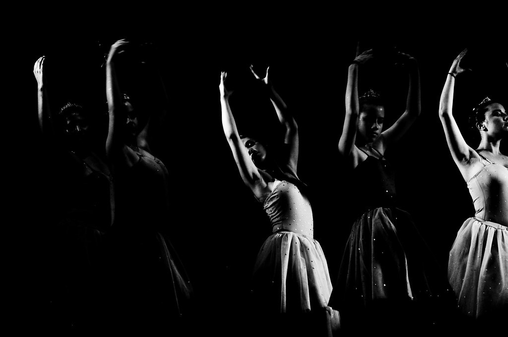 young diverse group of women dancing in ballet outfits