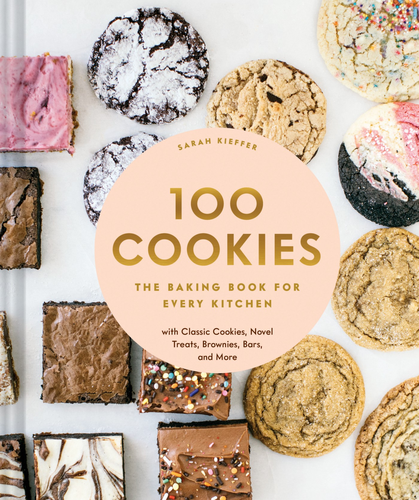 """The cover of """"100 Cookies: The Baking Book for Every Kitchen,"""" which is covered with different kinds of cookies."""