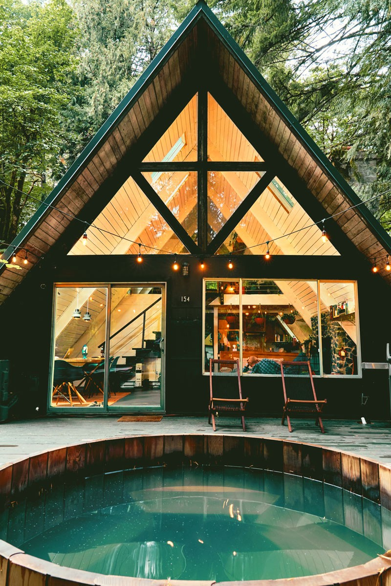 A view of an A-frame house in Packwood, Washington, including the hot tub.