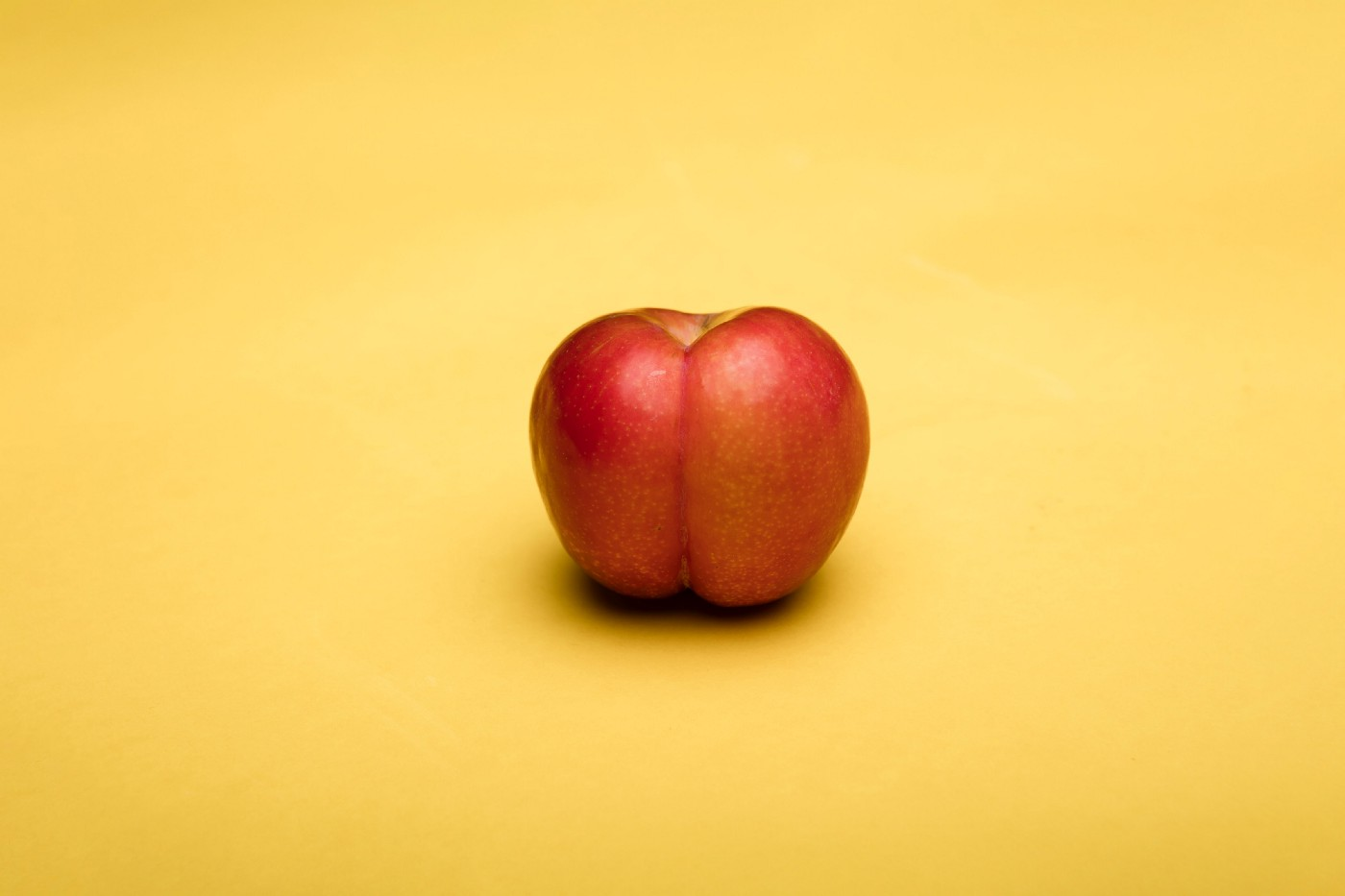 Metaphorically loaded image of a peach that looks like a human butt