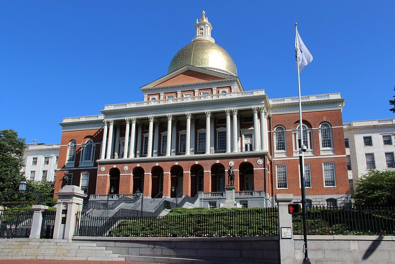 Front of the Massachusetts State House on a sunny day.
