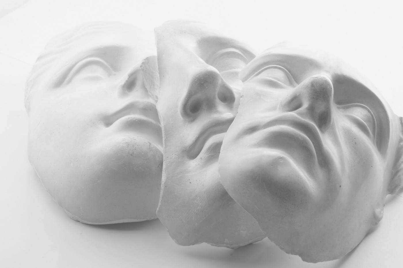 A photo of three white face masks (the marble kind, not the skincare kind).