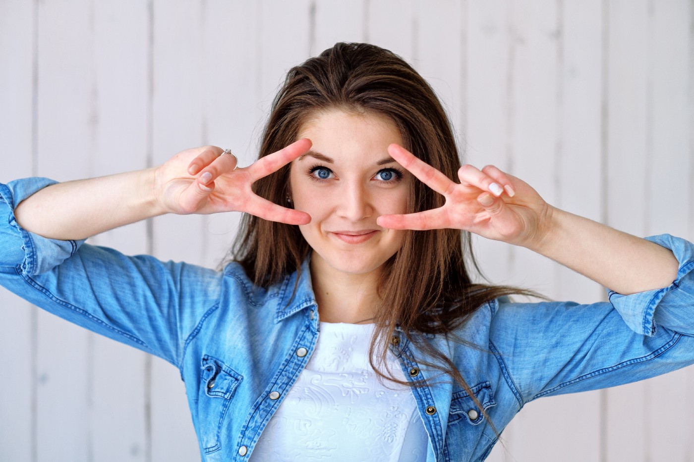 woman with fingers in front of her face