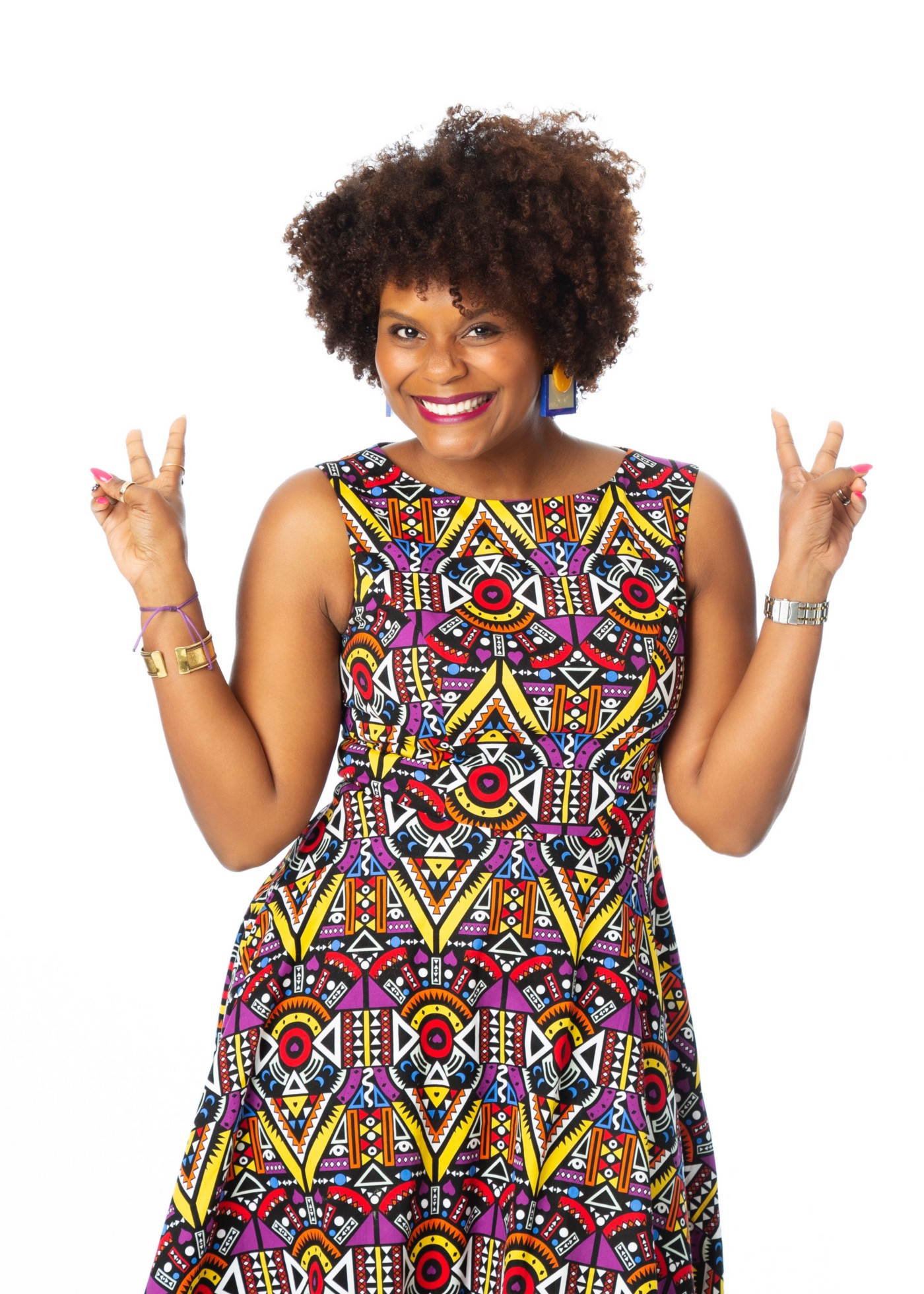 A photo of Tabitha Brown posing with peace signs.