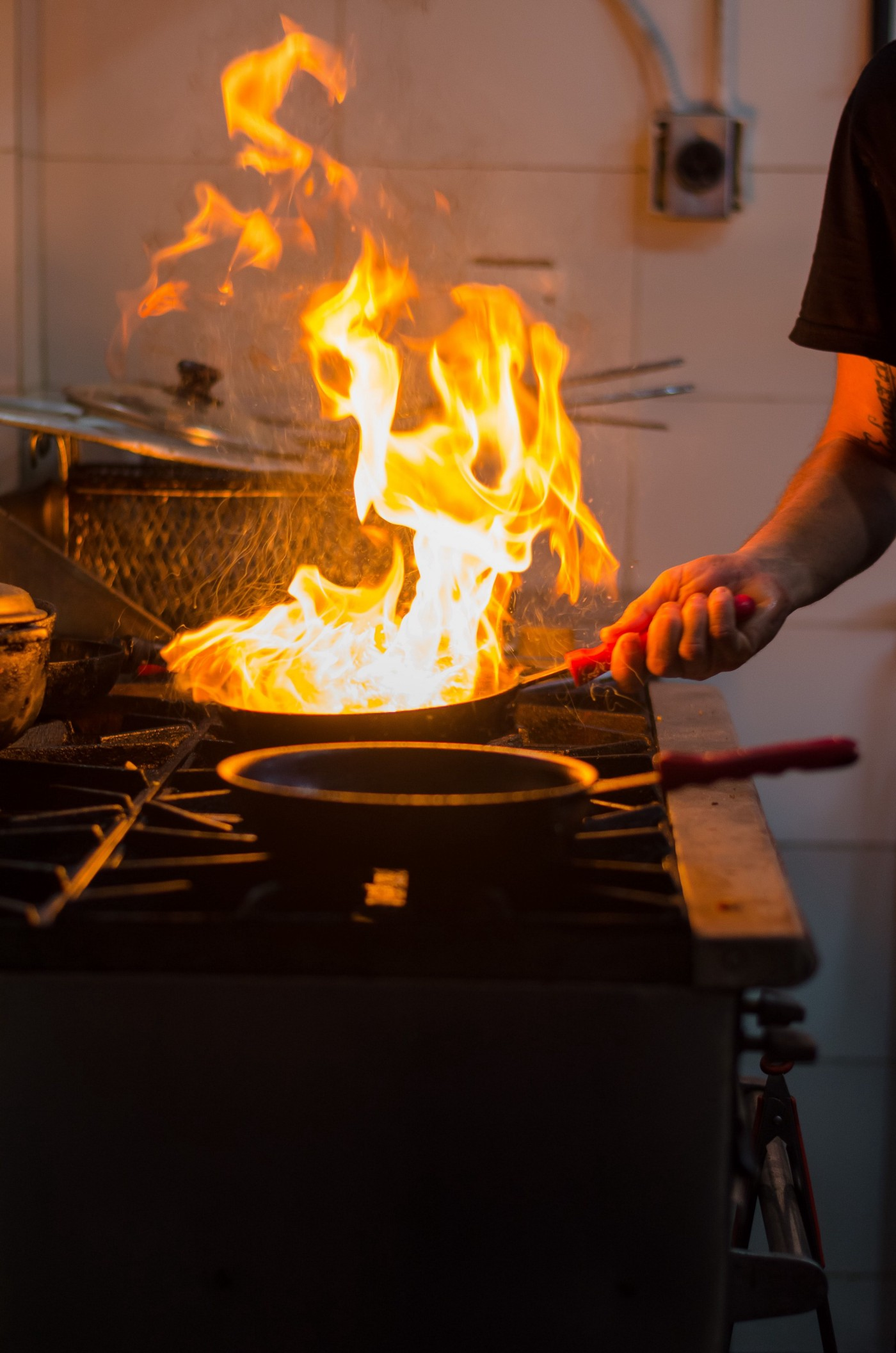 Flaming saute pan in an industrial kitchen