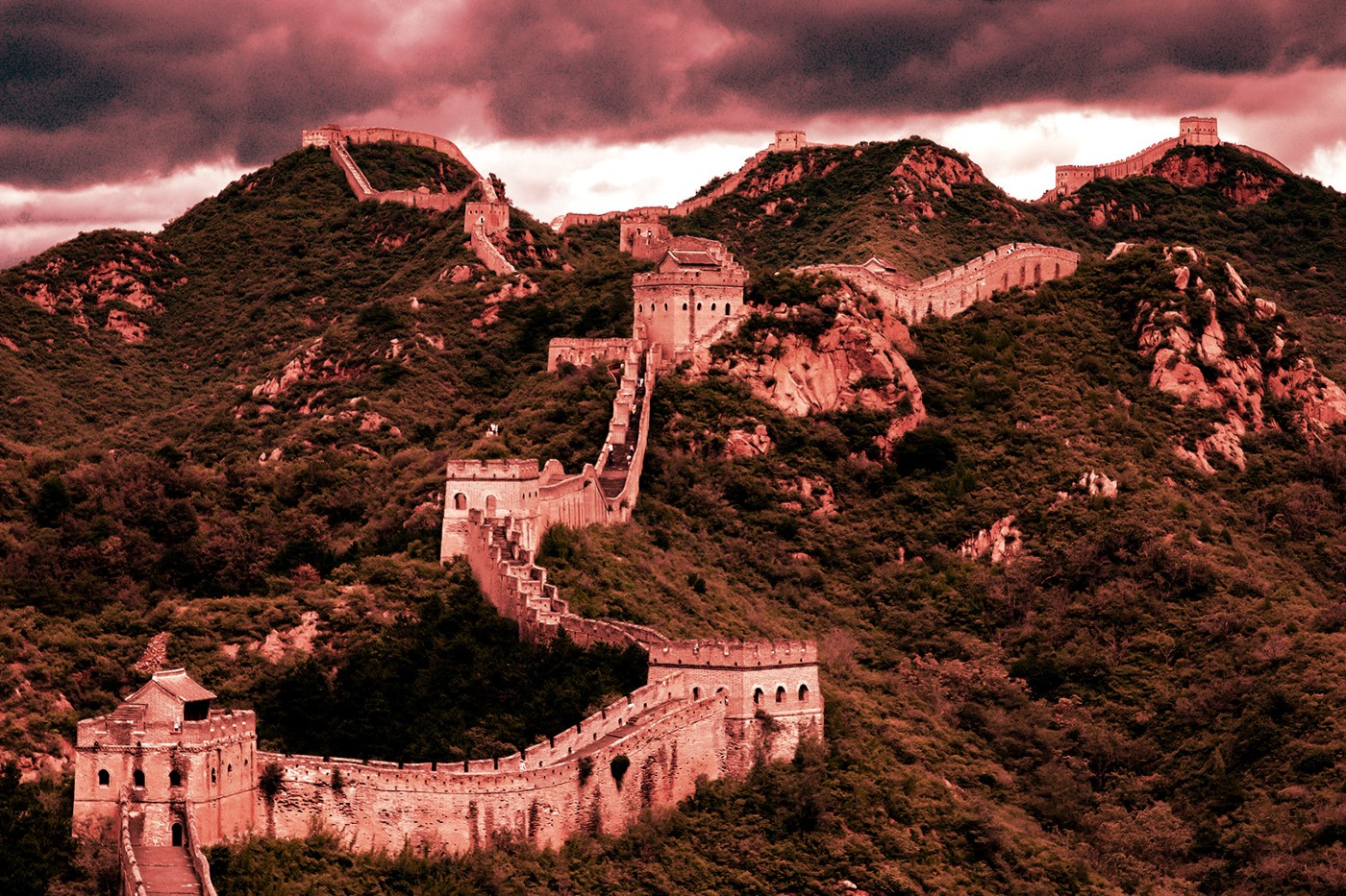 The Great Wall of China and surrounding hills overlaid with a red filter.