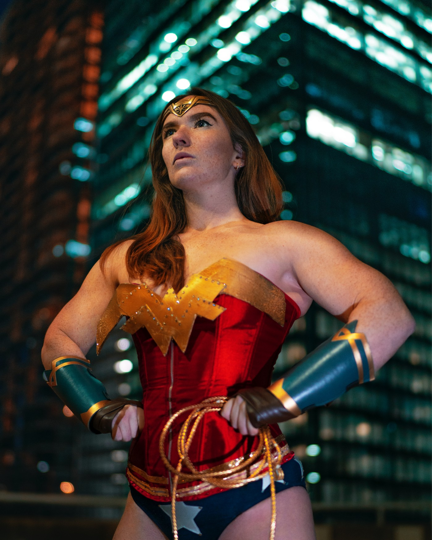 Woman in a red, gold, and blue Wonder Woman outfit with gold-trimmed blue sleeves with a golden head piece.