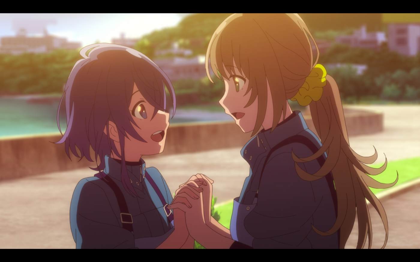Kukuru and Fuuka holding hands and looking at each other, excited that Fuuka is allowed to stay.