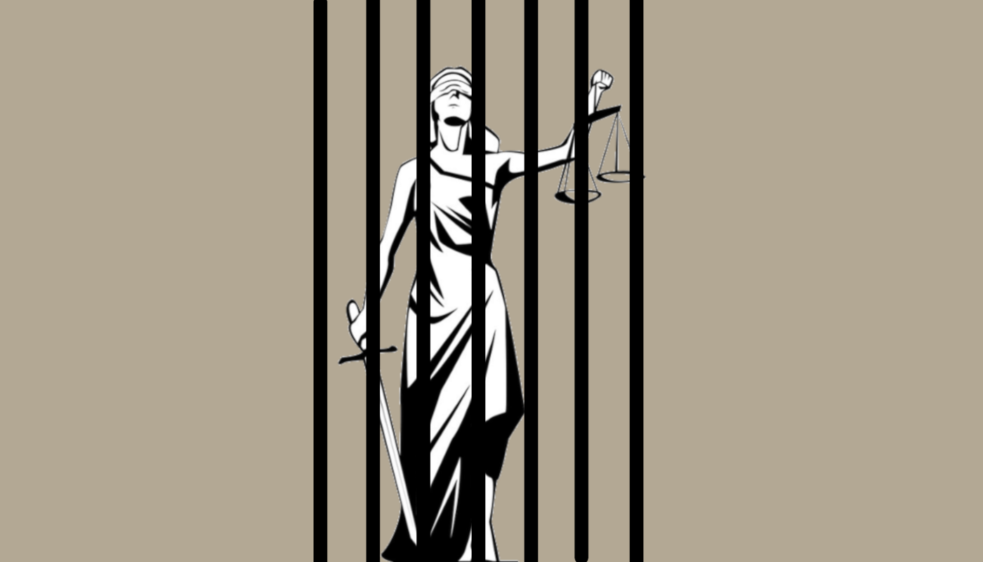 Lady Justice behind prison bars