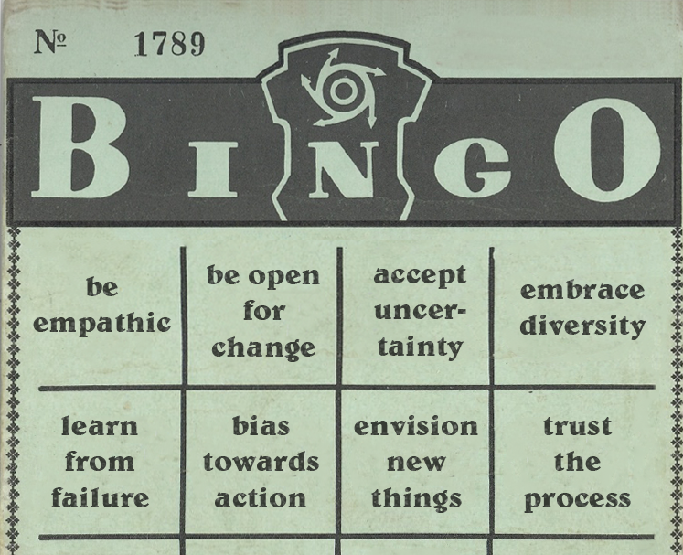 Old, green bingo card with some design mindsets instead of numbers: be emapthic, be open for change, accept uncertainty, embrace diversity, learn from failure, bias towards action, envision new things, trust the process.