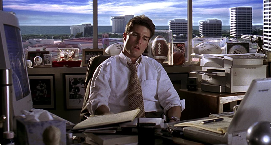 Tom Cruise looking disappointing in an office.