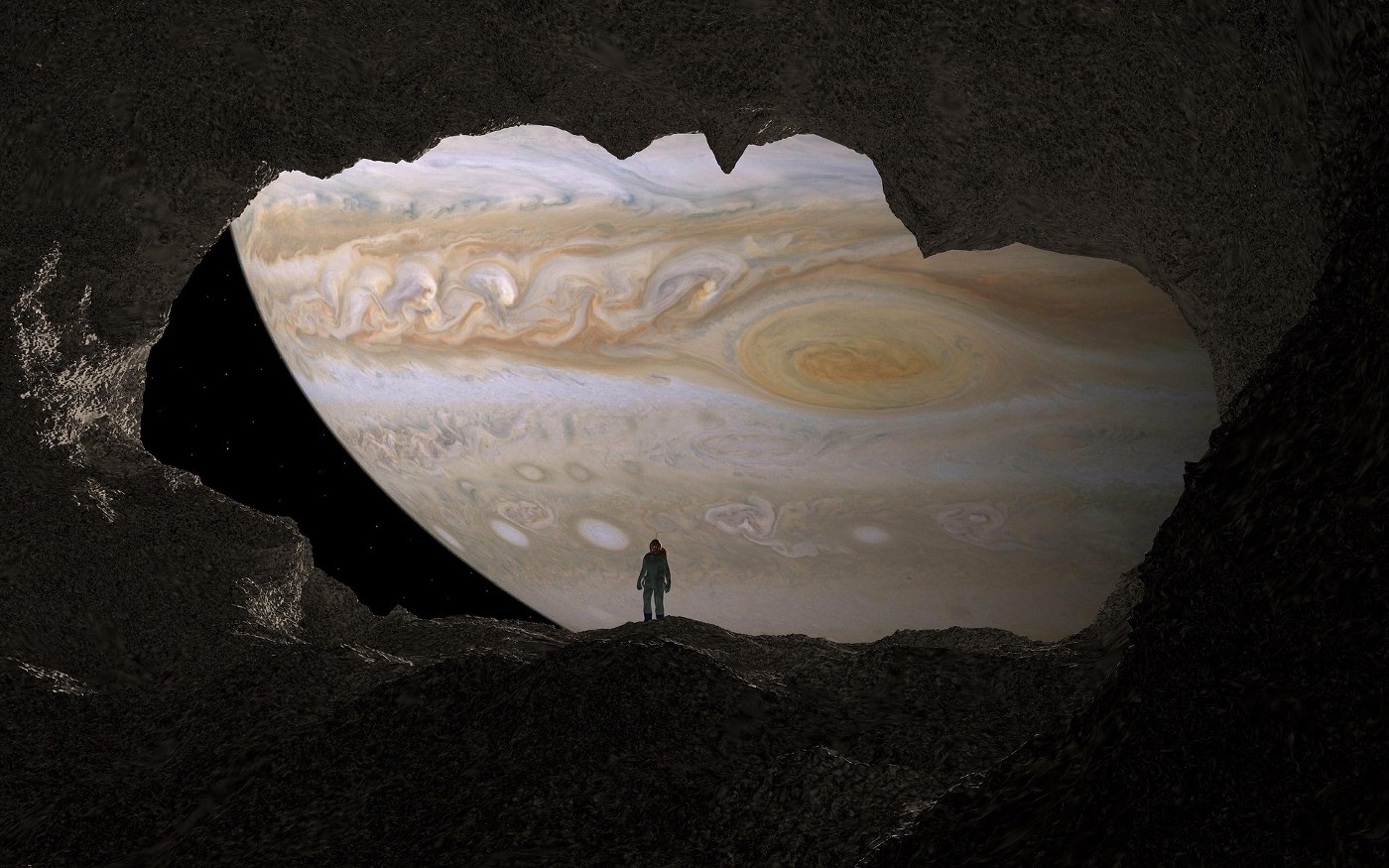 A human standing in front of Jupiter
