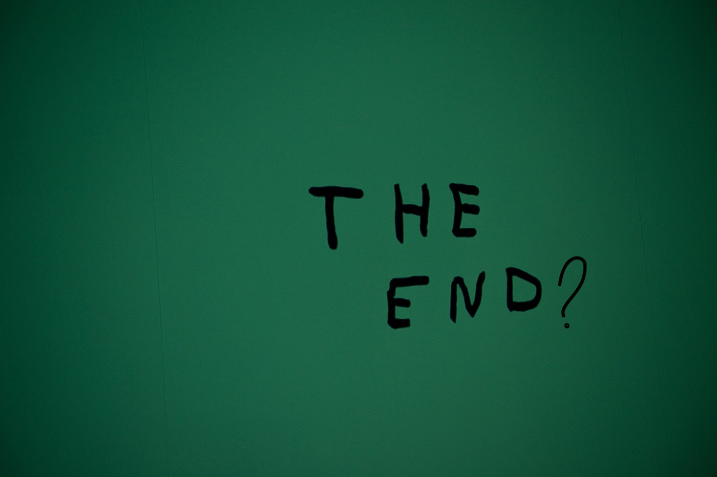 """A photograph with the text """"The End?"""" on a green background."""