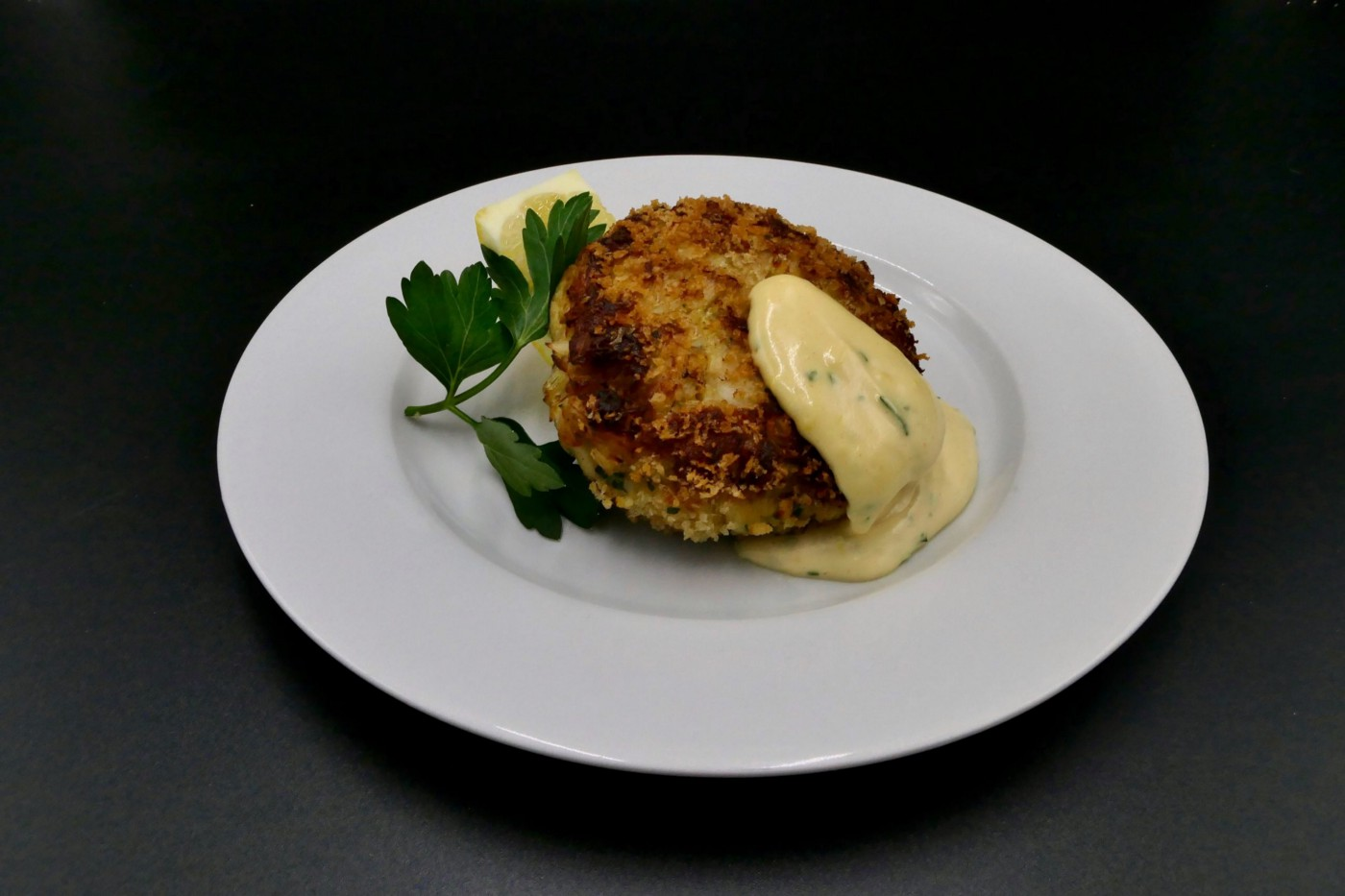 Crab cake nicely plated