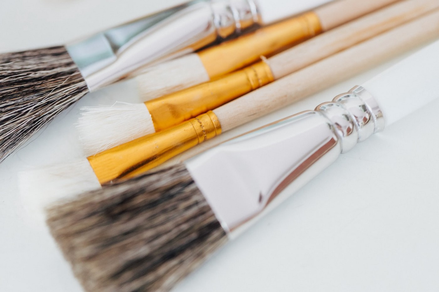 Five paintbrushes side by side