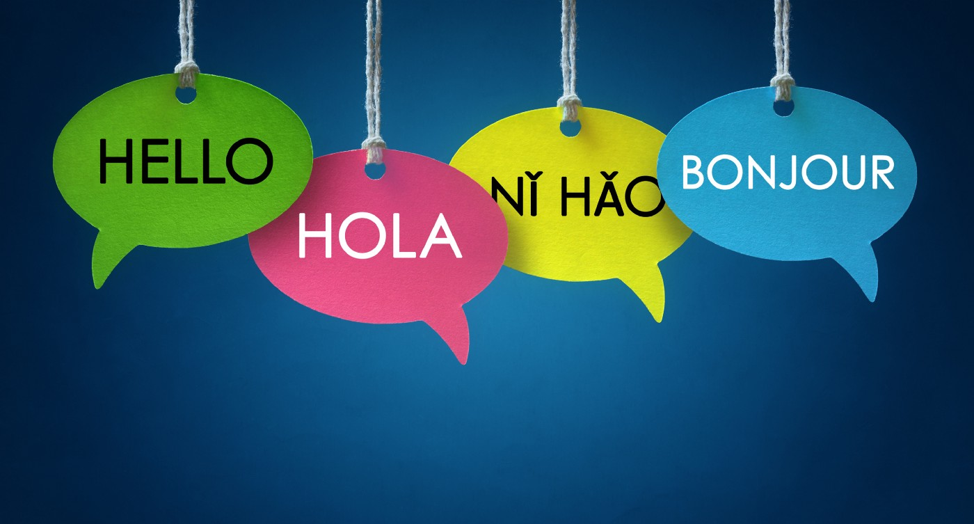 Multicolored speech bubbles that say 'hello,' 'hola,' 'ni hao,' and 'bonjour'