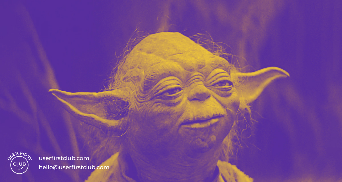 A duotone image of Master Yoda with the User First Club logo and contact details displayed on the left bottom corner.