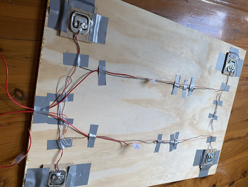 The four load cells are mounted to each corner and wired together