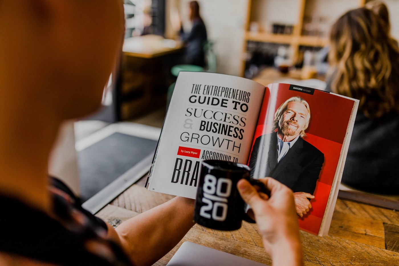 Man reading guide to success and business growth