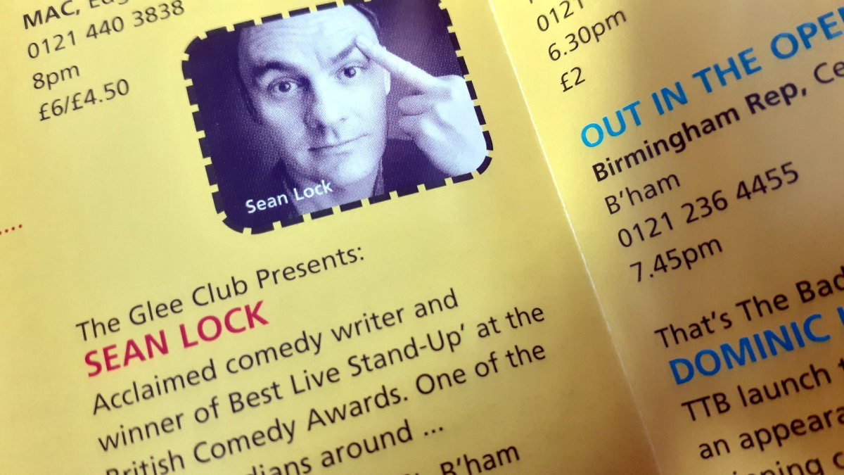 A photo of the festival's 2001 brochure featuring a picture of a young Sean Lock.