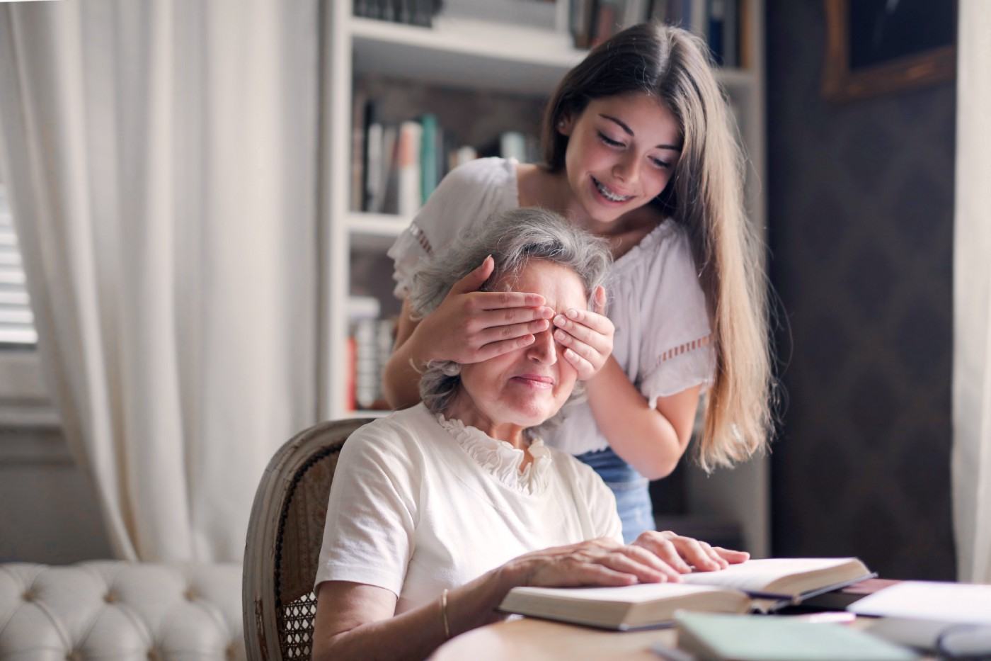 A young woman suprises her grandmother