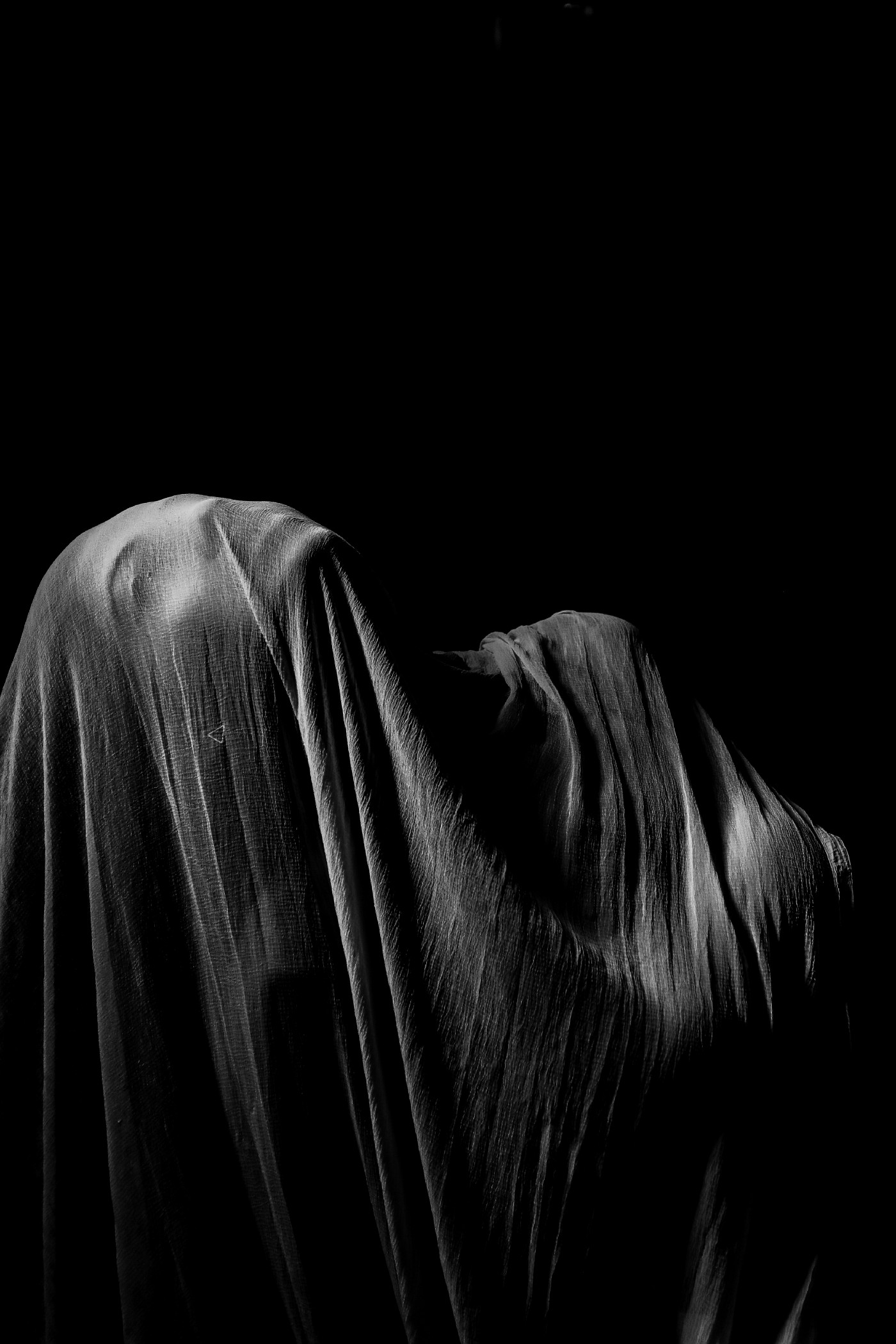 A woman covered in a cloth hiding her personality