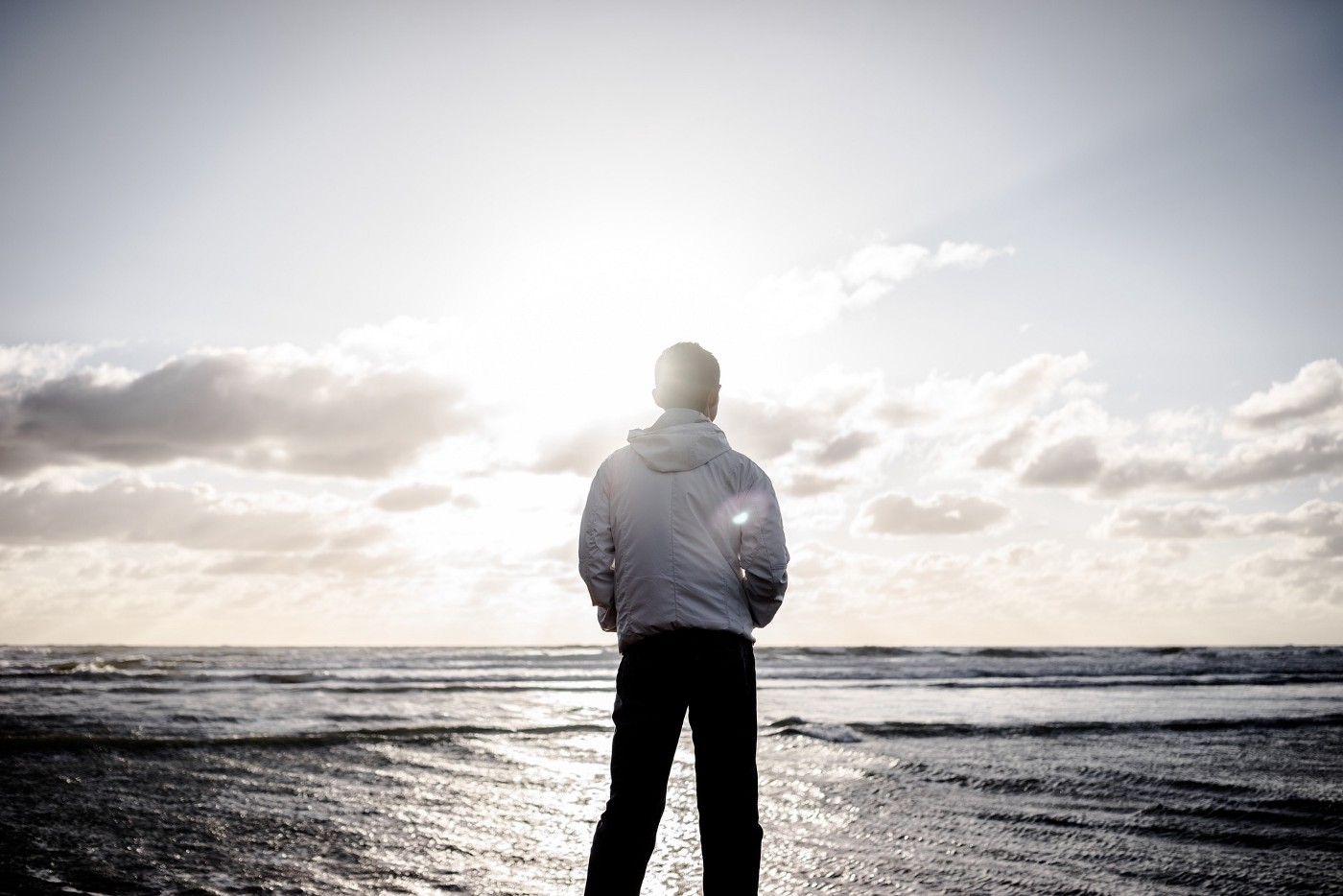 Person staring out at the ocean