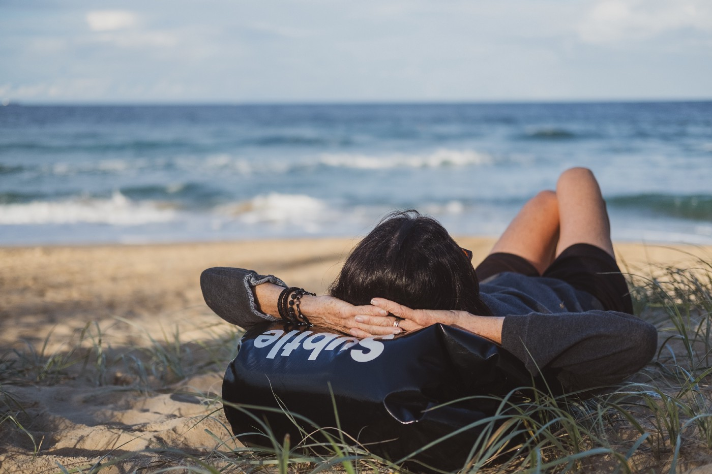 Person resting on the beach.