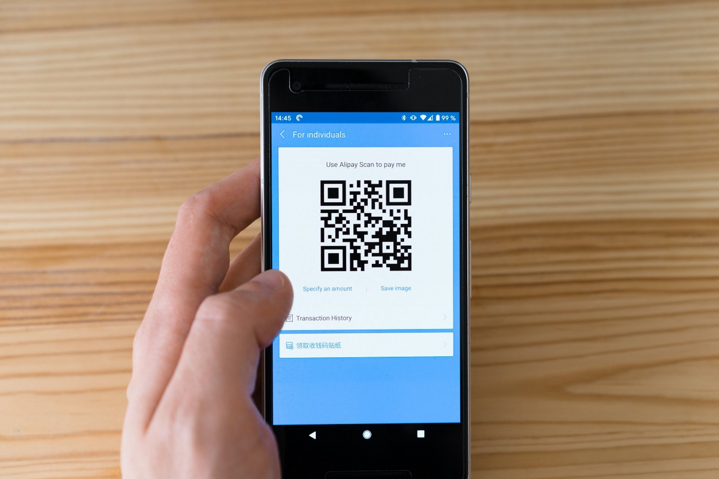 A mobile phone with a QR code on its screen.
