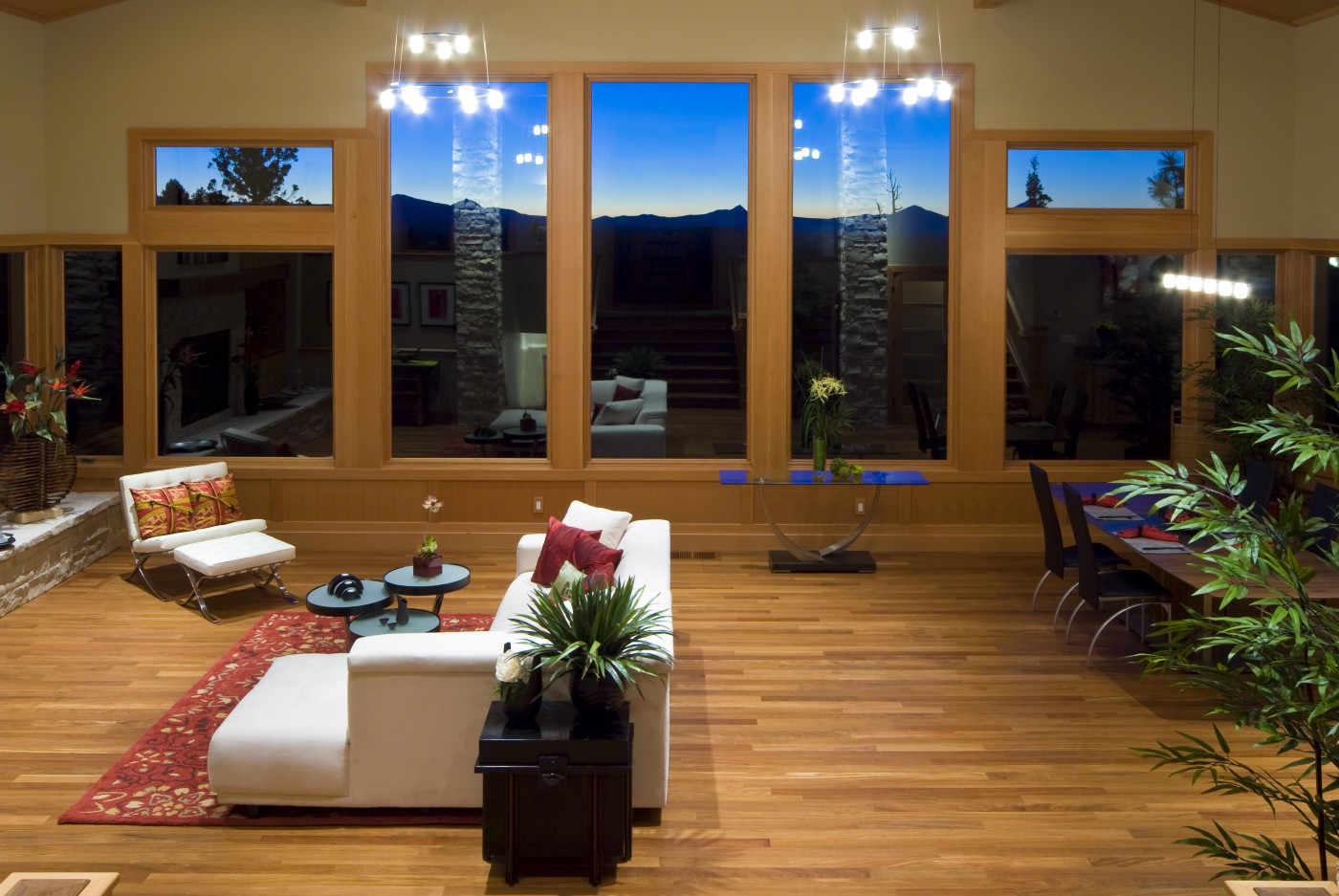 A clean and spacious living room with twilight view.