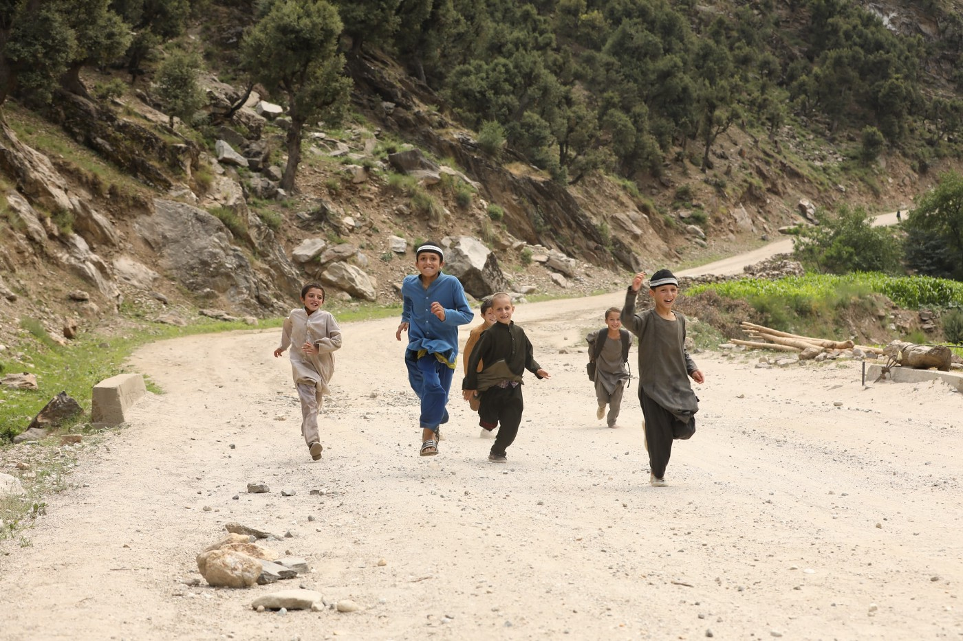 Children running along a road in Afghanistan.