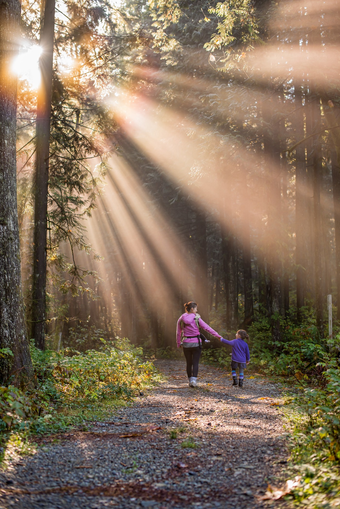 Mother and son going on a hike in the forest spending quality time together.