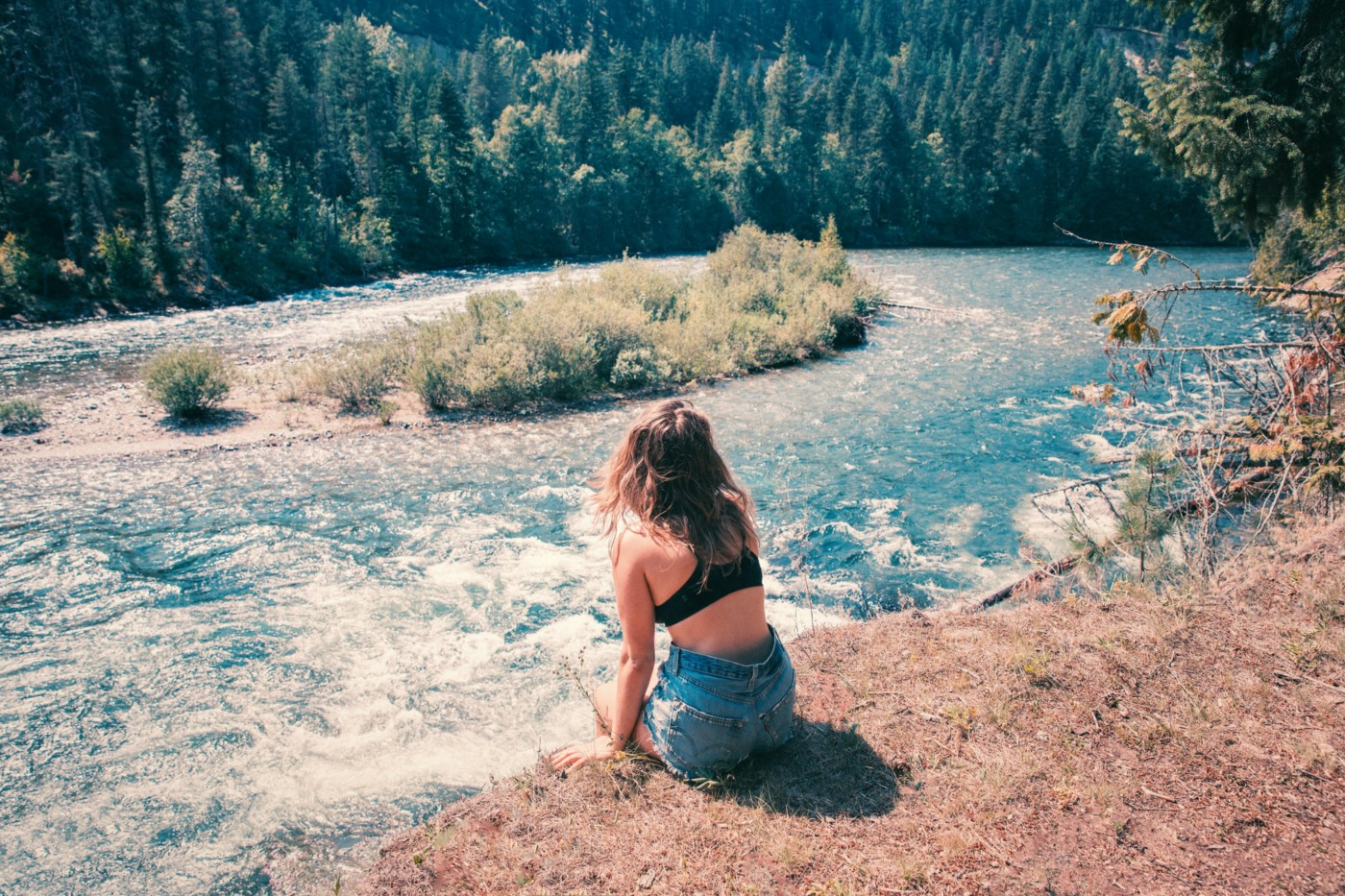 A person sitting by a river.