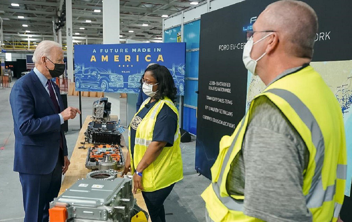 """Biden speaks to Ford workers in front of a banner that reads, """"A Future Made In America."""""""