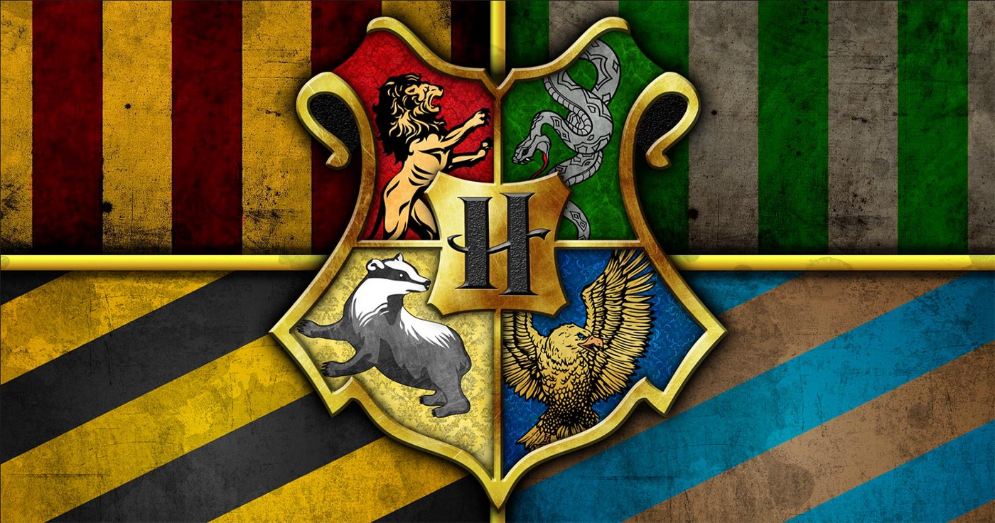 The Hogwarts crest with the four House insignias—Gryffindor, Slytherin, Hufflepuff, and Ravenclaw.