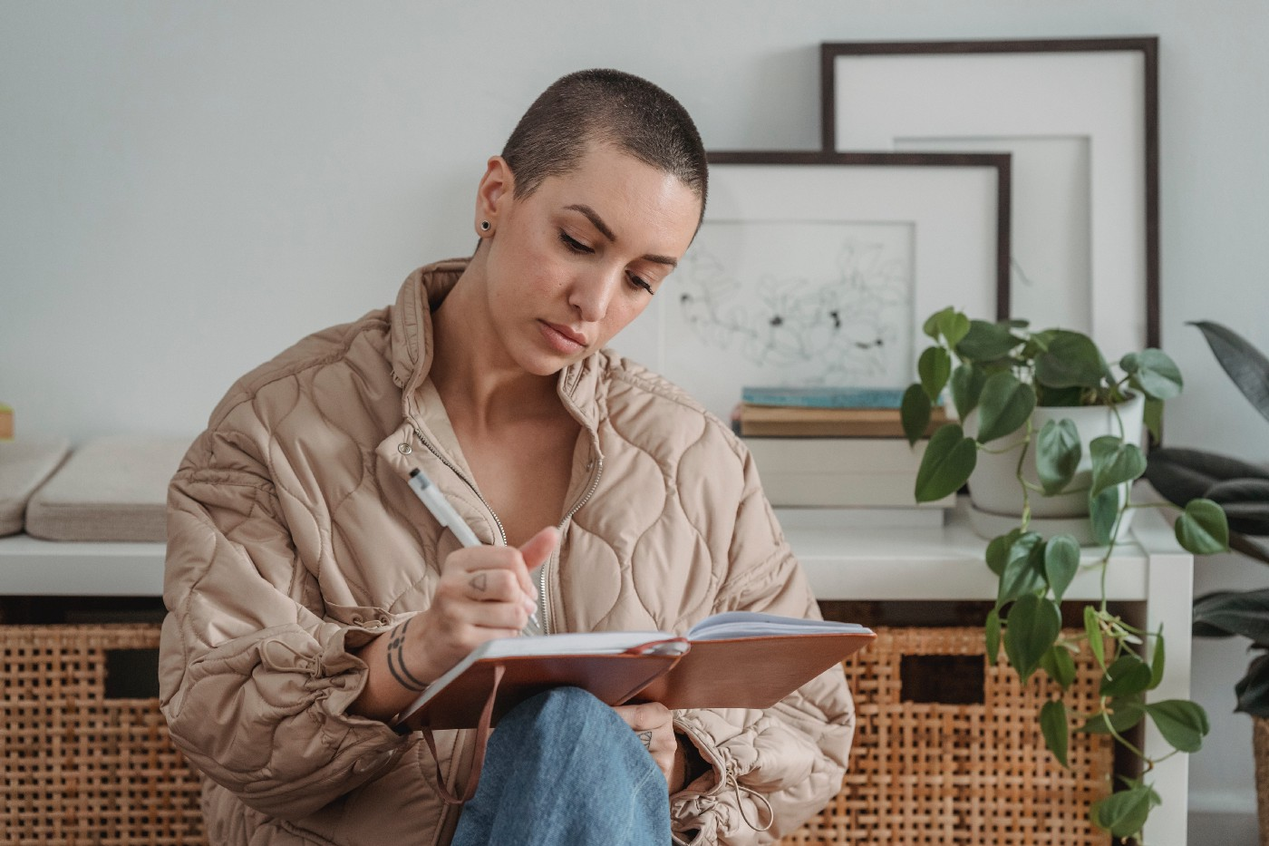 Woman writing in her notebook at home.