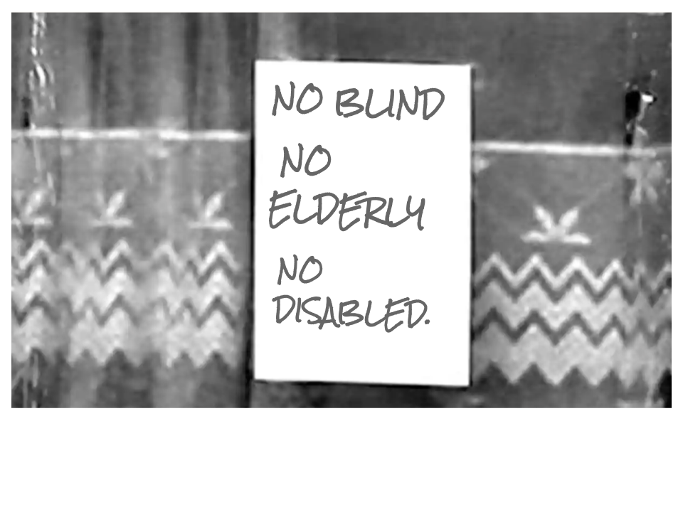 Black & white dated image from the 70's of a poster in a window stating No Blind, No Elderly, No Disabled