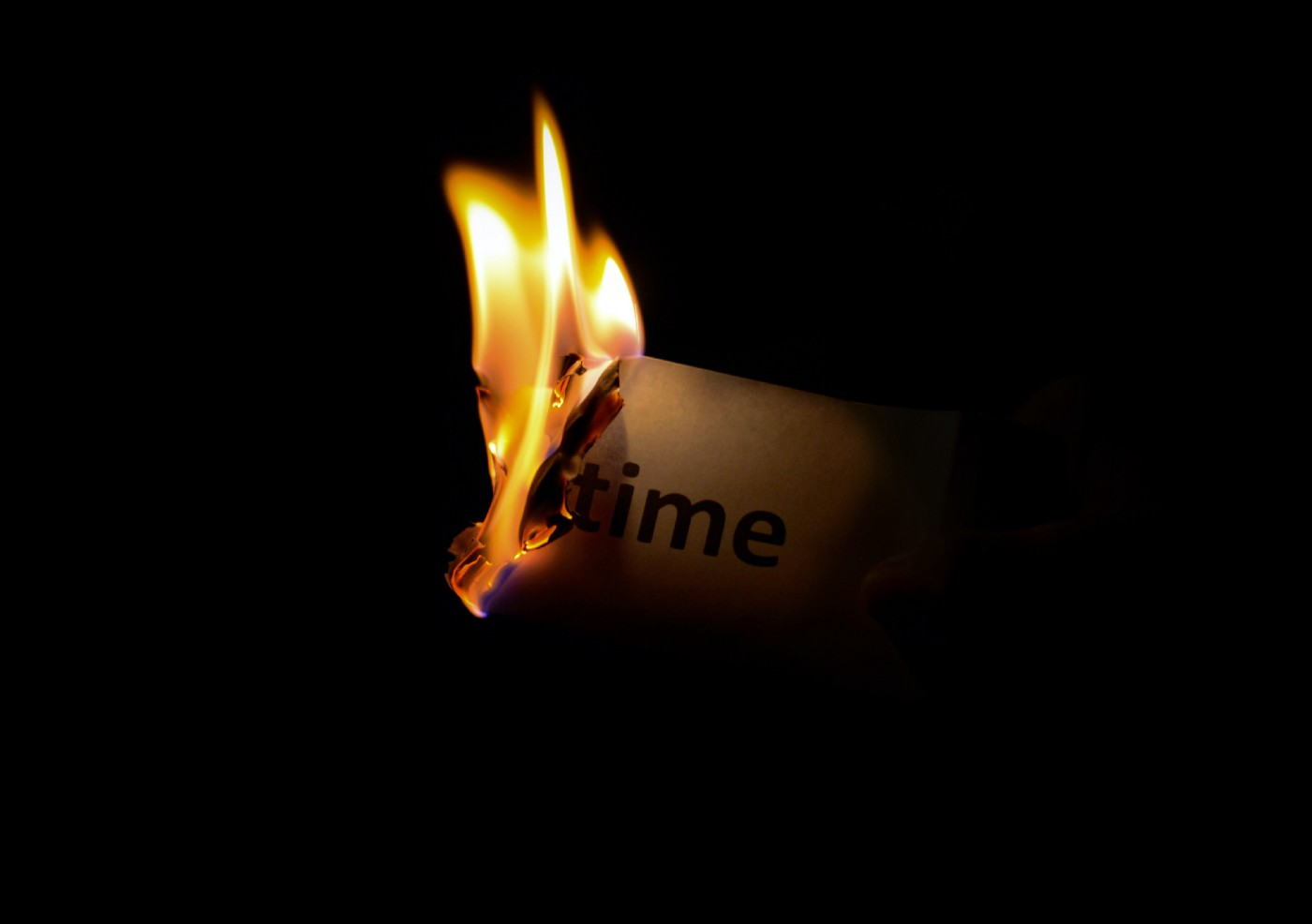 "A paper where it is written ""time"" burning"