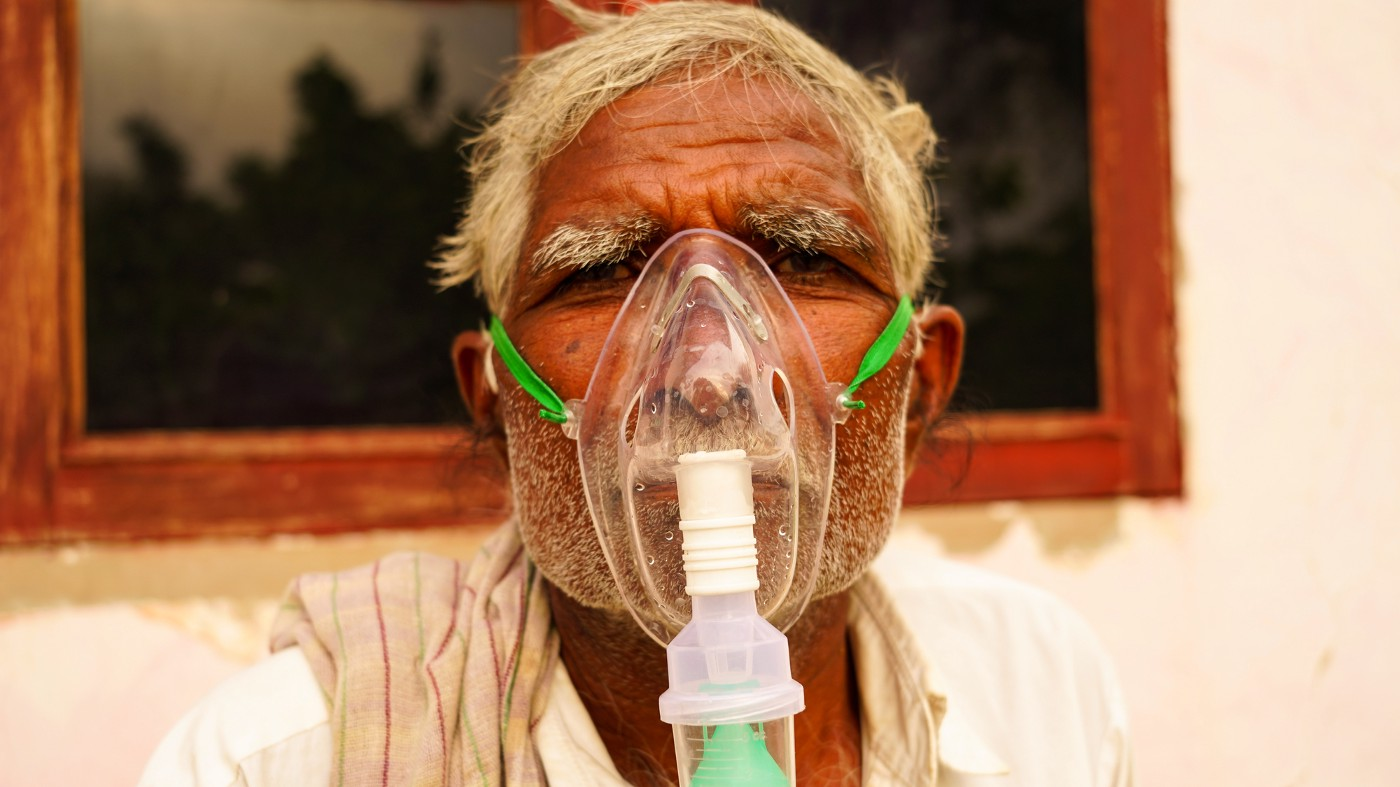 indian man with oxygen mask