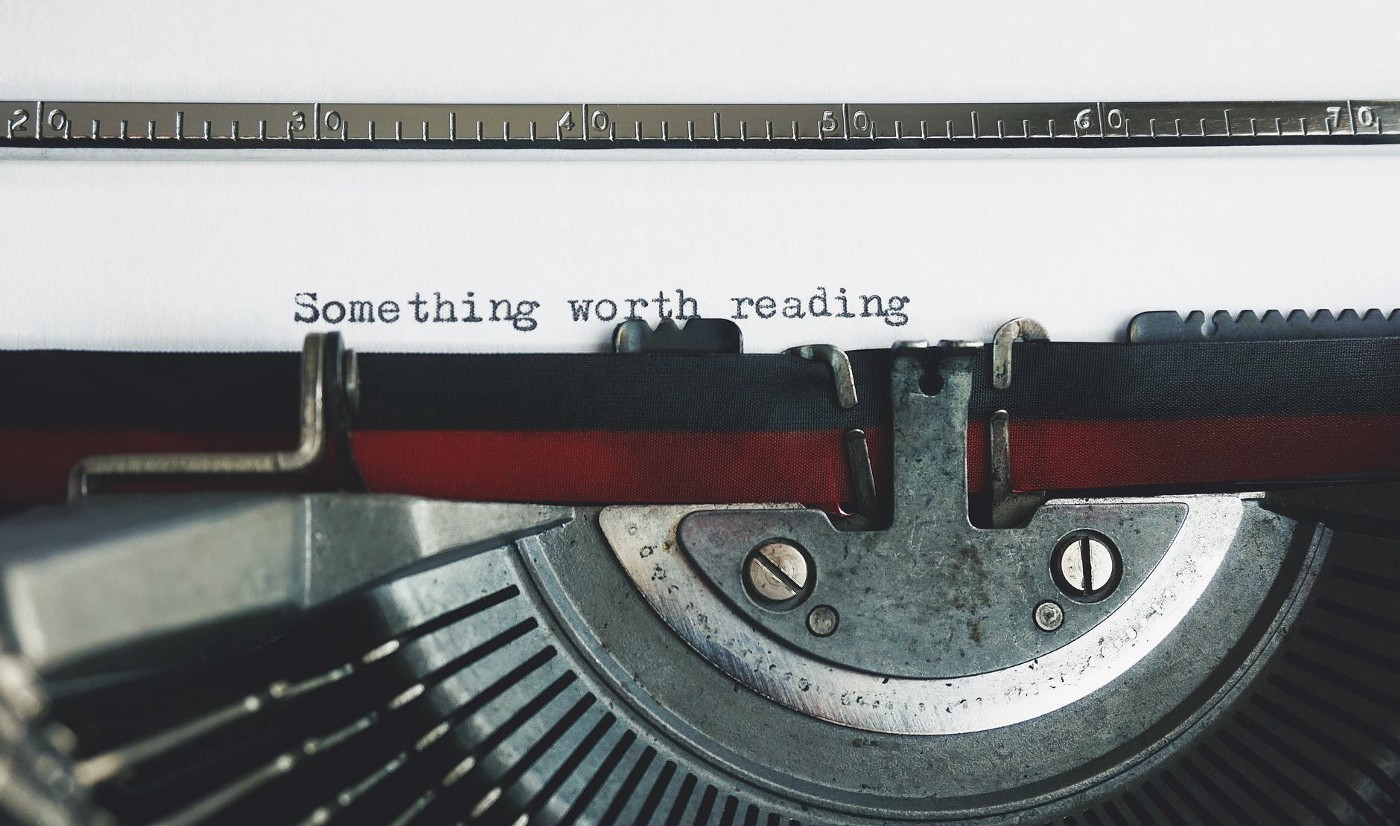 Typewriter typing out the words Something Worth Reading