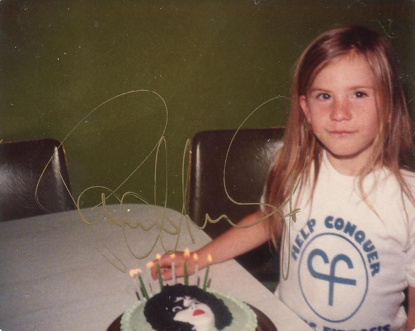 Girl with birthday cake showing Paul Stanley's face
