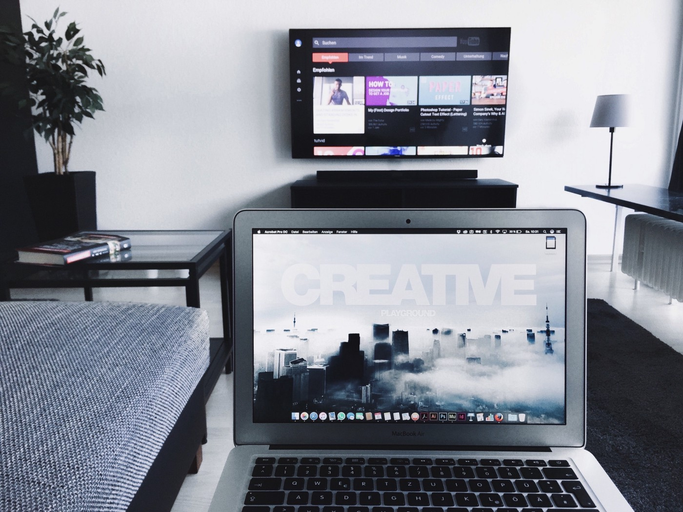 A laptop and a mounted television.