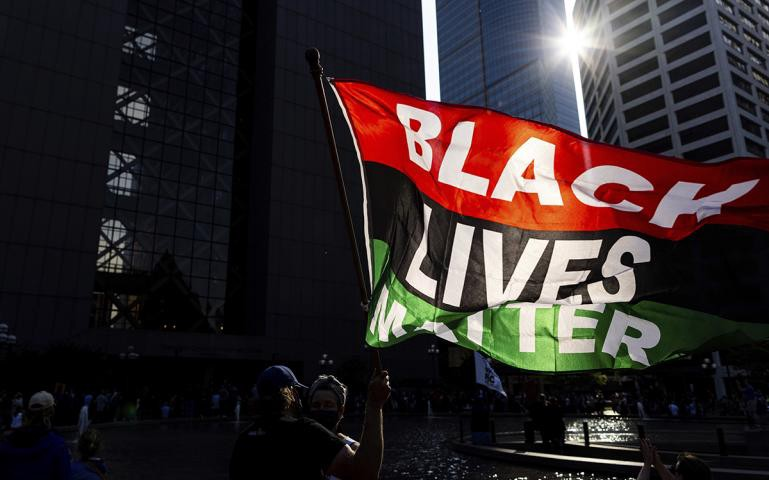 """Red, Black, and Green """"Black Lives Matter"""" flag flying in the sun"""