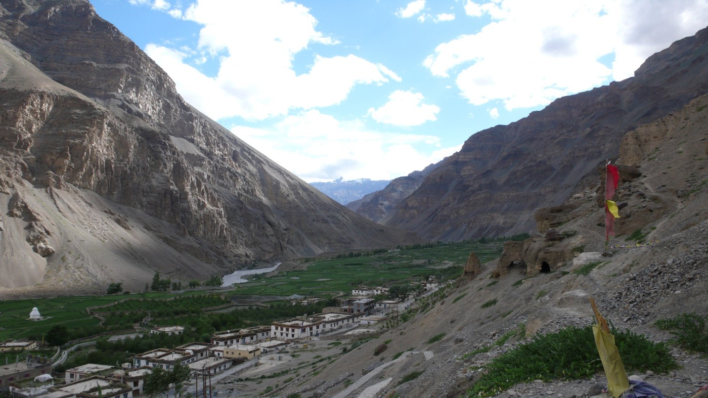 A photo of Tabo, in Himachal Pradesh. A tiny strip of arable land alongside the surging Spiti River and a 1,000 year old monastery and school. The mountain peaks overshadowing either side of the valley rise to 6,000M. The village has a network of green fields of potato, peas and a few apple trees and poplars. Maybe 3–4,000 people live there, mostly in traditional houses of mud brick, of two stories with a flat thatched roof used for storage. I once lived here for a month. I miss it very much.