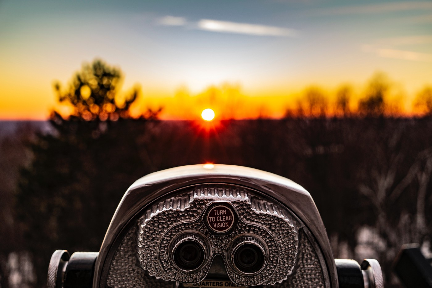 Coin operated tower viewer looking at a sunset